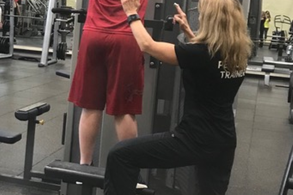 Kathy Hensler trains a client at the Rose E. Schneider Family YMCA in Cranberry.