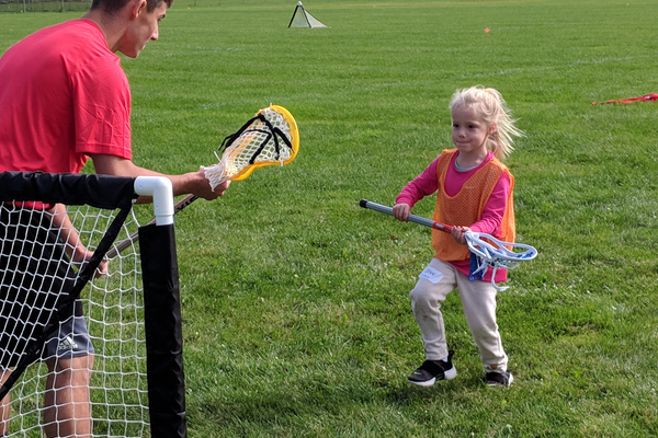 Connor Charron guards the net while Olive Ginsburg attempts a shot during one session of Tewksbury Lacrosse's fall clinic. (Courtesy photo)