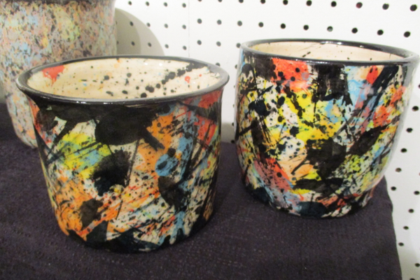 Two cups with spattered designs by Rick Hohenwarter.