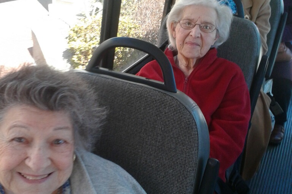 Senior riders on their way to appointments and grocery shopping on NHCO's Free Rides for Seniors shuttle.