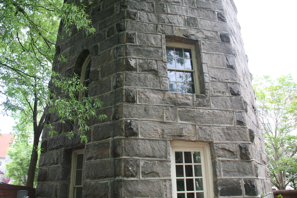 The granite stone portion of the tower on the courtyard side
