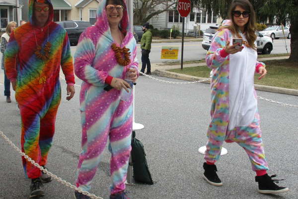 Three friends arrived in onesies, ready to sample some brews.