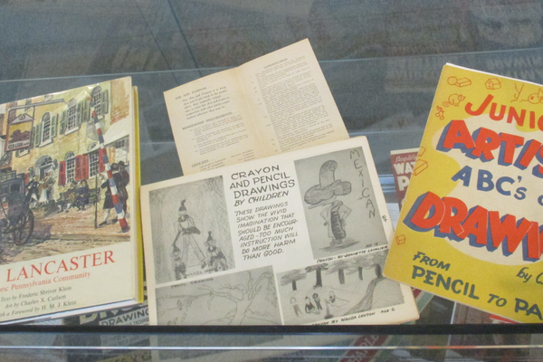 An exhibit of Carlson's art instruction books.
