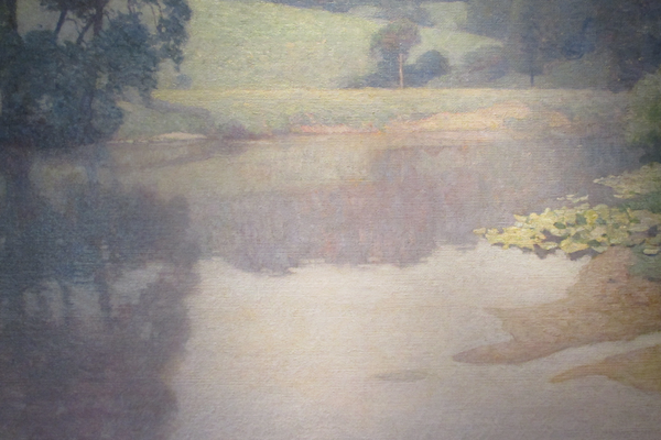 An untitled landscape reflected in water from 1912. (On loan from private collection)