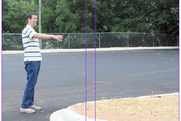 Cherryville Elementary School Principal Shawn Hubers points to the new work done on the school's cafeteria side parking area and driveway. In addition to the paving of it, there has also been some landscaping done as well.