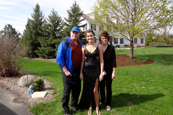 Katy with Mom and Dad before heading off to prom