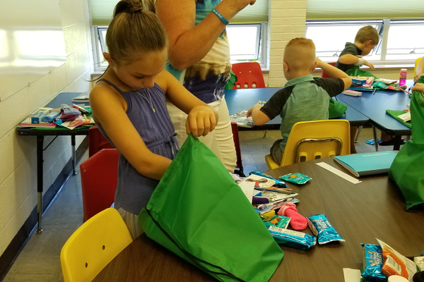 Children from North Hills Community Baptist Church make welcome bags for immigrant children to be dispersed through THRIVE's efforts. Photo courtesy THRIVE