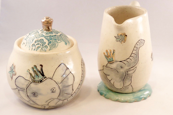 An elephant-themed sugar bowl and creamer.