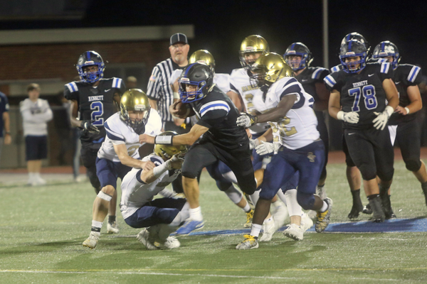 Kennett's Sam Forte, number 7, escapes an attempted tackle by Sun Valley defense.