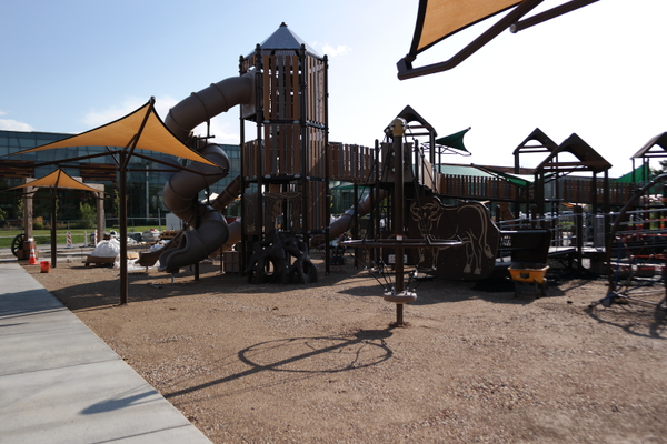 The nearly completed Wild West Jordan playground mimics the old playground with tall towers The dirt will be covered with a colored, springy surface for play.. (Erin Dixon/City Journals)