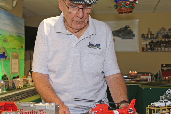 Yard master Bob Undercuffler displays a recently acquired train car that carries a helicopter.