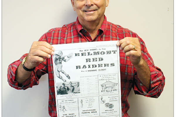 Class of 1969 member David Abernethy with a 1968 football schedule.