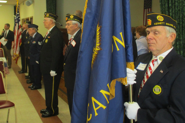 Members of the William W. Fahey Post 491 Color Guard stand at attention during the Pledge of Allegiance.