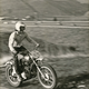 Randy motorcycling in the backyard, now Pico Plaza (1970).
