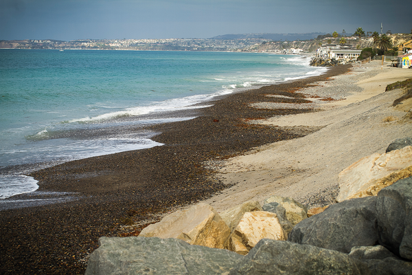 Erosion of the sand at North Beach has exposed a rocky layer at the shore.