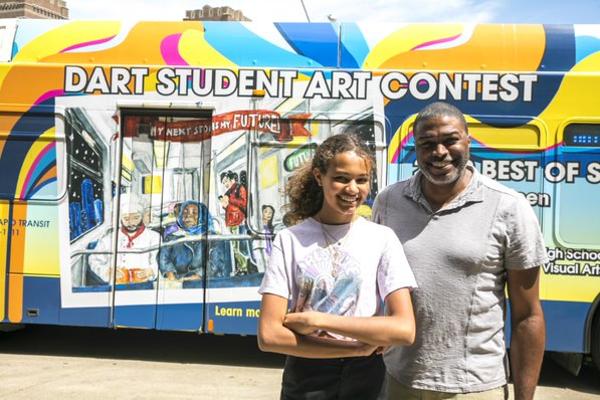 2019 20student 20art 20contest 20winner 20sarah 20thigpen 20and 20her 20father 20stand 20in 20front 20of 20a 20dart 20bus 20wrapped 20with 20her 20artwork  20 002