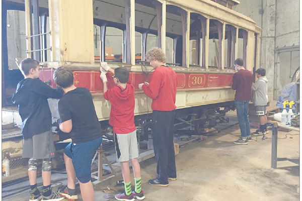 Scouts from Troop 56 during a recent restoration work day on the trolley.