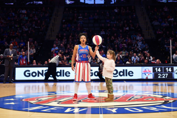 woman from Harlem Globetrotters, little girl
