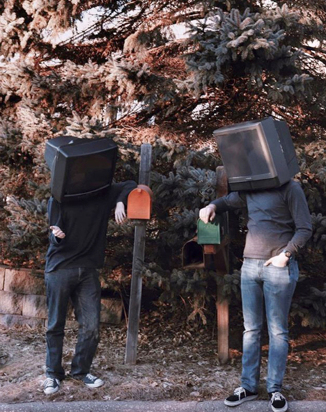two people leaning on mailboxes/heads inside TVs