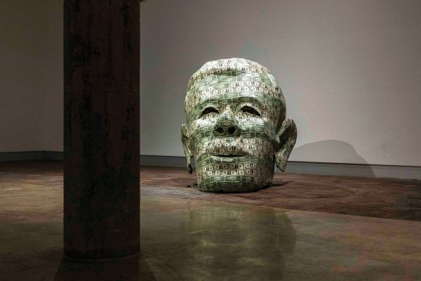 A giant human male head made from dollar bills