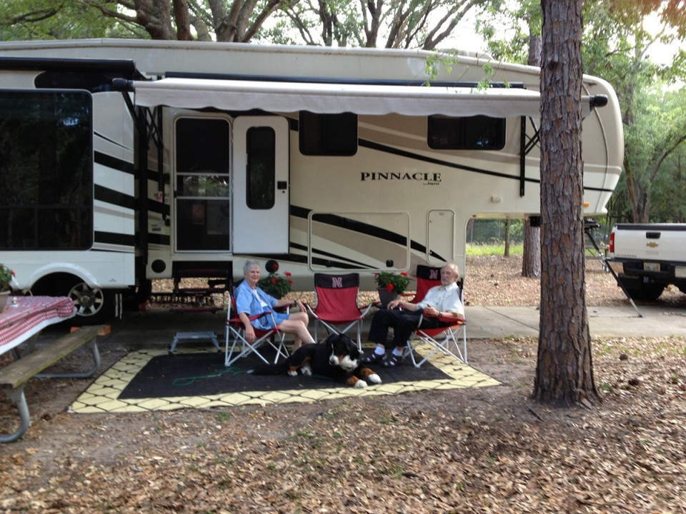Dr. Marvin and Joy Johnson with their travel companion, Barney, at a campsite in Orlando, Fla.