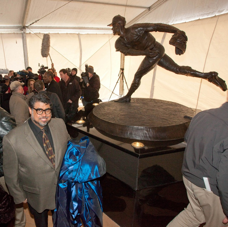 Alston with his statue at the unveiling. Photo by Dave Jenkins.