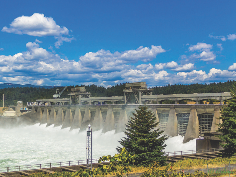 The Bonneville Dam and Powerhouse gushes whitewater downstream
