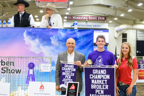 winners, announcers at Purple Ribbon Stock Show