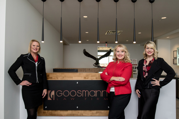three lawyers of Goosman Law Firm
