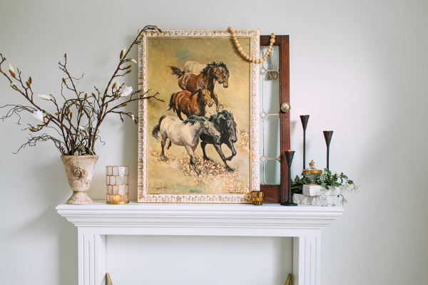 horse painting on white mantle