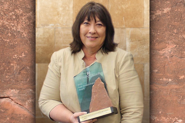 Ginger DeCavitch holds the 2019 State Archaeologist's Award