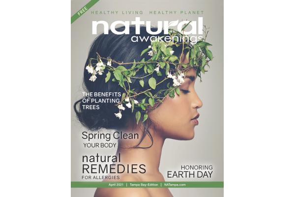 Natural Awakenings Magazine of Tampa April Cover with a side profile of a women with greenery around her head like a headpiece