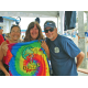 A specially-designed Ocean Festival T-shirt is presented  to Peggy, (a tye-dye enthusiast), by artist Bob Harlow and volunteer Kumi Elston.