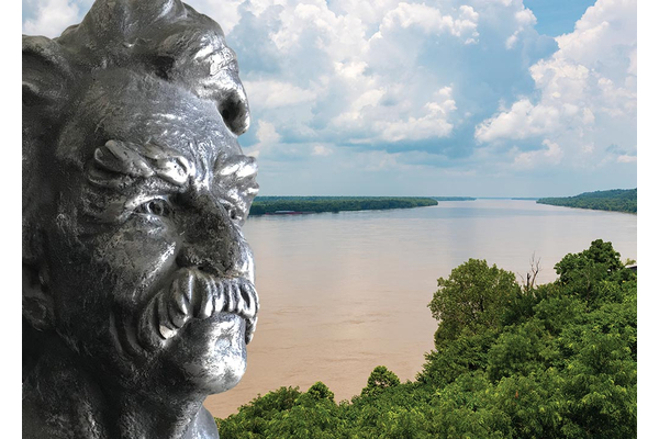 A bust of Mark Twain in front of the Mississippi River