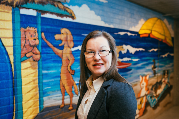 Theresa Murray in front of dog mural