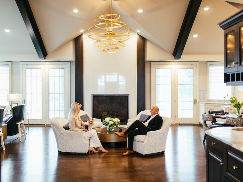 homeowners sit in vaulted living room