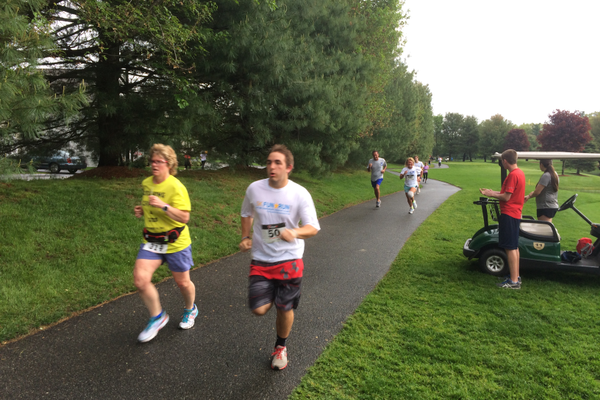 Barb Mathers and Connor Cote head to the finish line at the Tewksbury Memorial Day 5K Fun Run.
