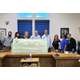 Shown L-R are School Board members Mark Flannery Lori Colombo Jennifer Altomonte Michael Reed and Eric Ormberg and BEF Board Members Christine Copper Rachelle Jean-Louis and Leanne Marino