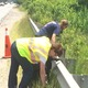 Planning Board member Nancy Reed and Rosalyn Impink cleans up along Route 38.