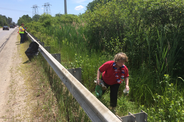 Elaine Williams cleans up along Route 38.
