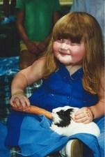 Medium_little_girl_feeding_guinea_pig.jpg