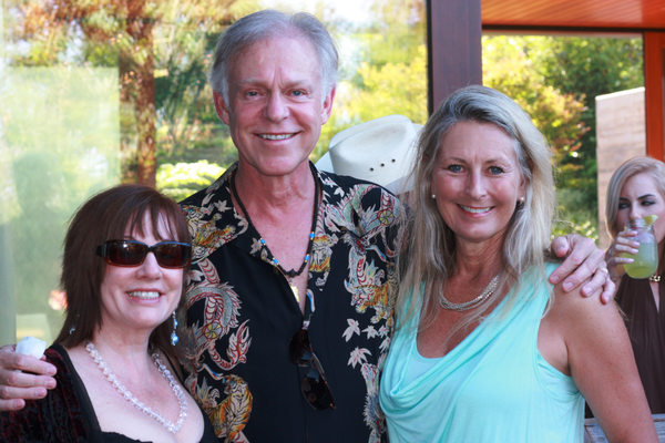 Manhattan Beach residents Valerie Maxwell, Scott Wilson and Jayne Justice enjoy the evening.