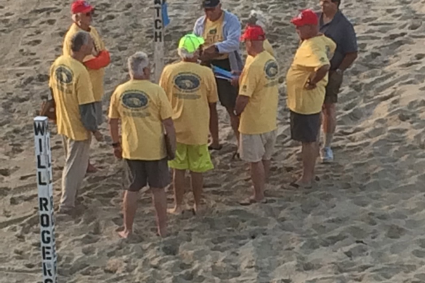 Officials talk strategy before the lifeguard competition