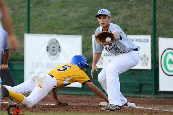 A Manhattan Beach/Hermosa Beach Junior League All Star gets back to the bag safely against a Texas team.