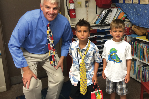 "Sharing his office with the ""Principal of the day."""