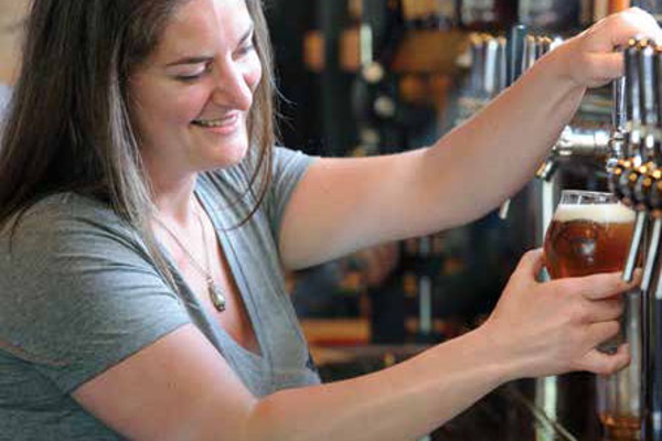 Kate Wise, called best bartender in Vermont by some, pours a pint